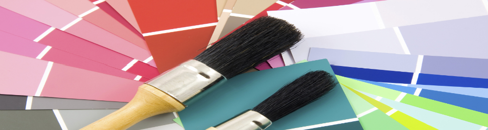 Paint brushes and color samples.